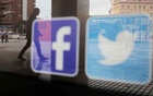 Facebook and Twitter logos are seen on a shop window in Malaga, Spain, Jun 4, 2018. REUTERS