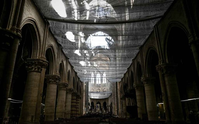 A picture shows a protective net inside the Notre-Dame Cathedral during the preliminary work in the Notre-Dame Cathedral one month after it sustained major fire damage in Paris, France May 15, 2019. REUTERS
