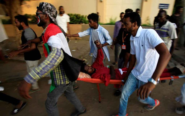 Civilians evacuate a Sudanese protester injured during demonstrations along a street in central Khartoum, Sudan May 15, 2019. REUTERS