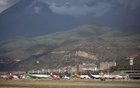 Aircraft are seen at a runway on the Simon Bolivar airport in Caracas. Reuters