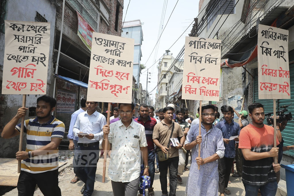 Residents of Jurain in Dhaka marching in the neighbourhood on Friday demanding that the WASA supply drinkable water and compensate for polluted water. Photo: Abdullah Al Momin