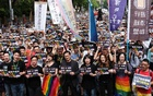 Same-sex marriage supporters take part in a rally during parliament discussion on three different draft bills of a same-sex marriage law, outside the Legislative Yuan in Taipei, Taiwan May 14, 2019. REUTERS
