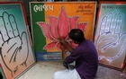 An electrician tests LED-light fitted boards with symbols of India's ruling Bharatiya Janata Party and main opposition Congress party at a workshop in Ahmedabad, India, Apr 15, 2019. REUTERS