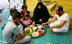 Widow Fatam Hadi Jabr, 56, breaks fast with her brother and her children during the holy month of Ramadan in the holy city of Najaf, Iraq May 12, 2019. REUTERS