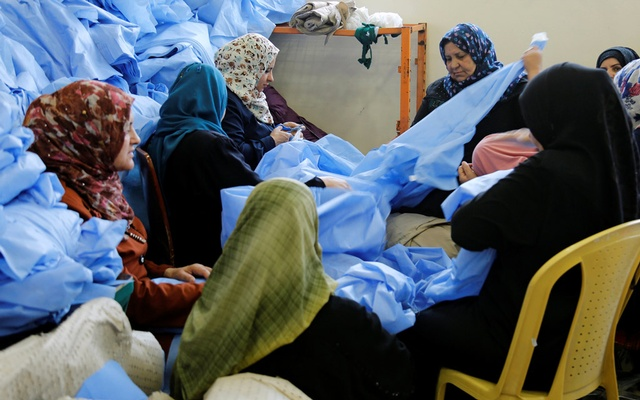 Widows and divorced women work at Waladi textile factory, part of which was destroyed by the war in Mosul, Iraq May 5, 2019. REUTERS