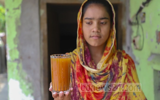WASA water at Paterbagh in Dhaka's Kadamtali is so much filled with rust from old iron pipes that it can easily be mistaken for orange juice. Photo: Abdullah Al Momin