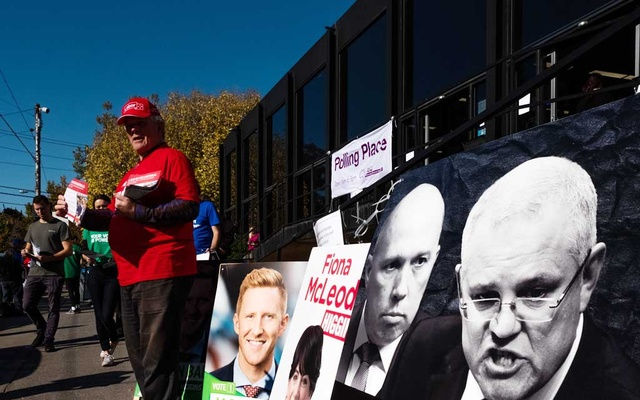 Campaign posters, including of Australia's Prime Minister Scott Morrison, far right, outside a polling station in Melbourne, Australia, May 18, 2019. The New York Times