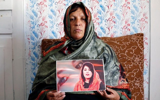 Anisa Mangal holds a photo of her daughter Mena Mangal, an Afghan journalist and parliamentary adviser, who was recently killed in Kabul, Afghanistan May 14, 2019. REUTERS
