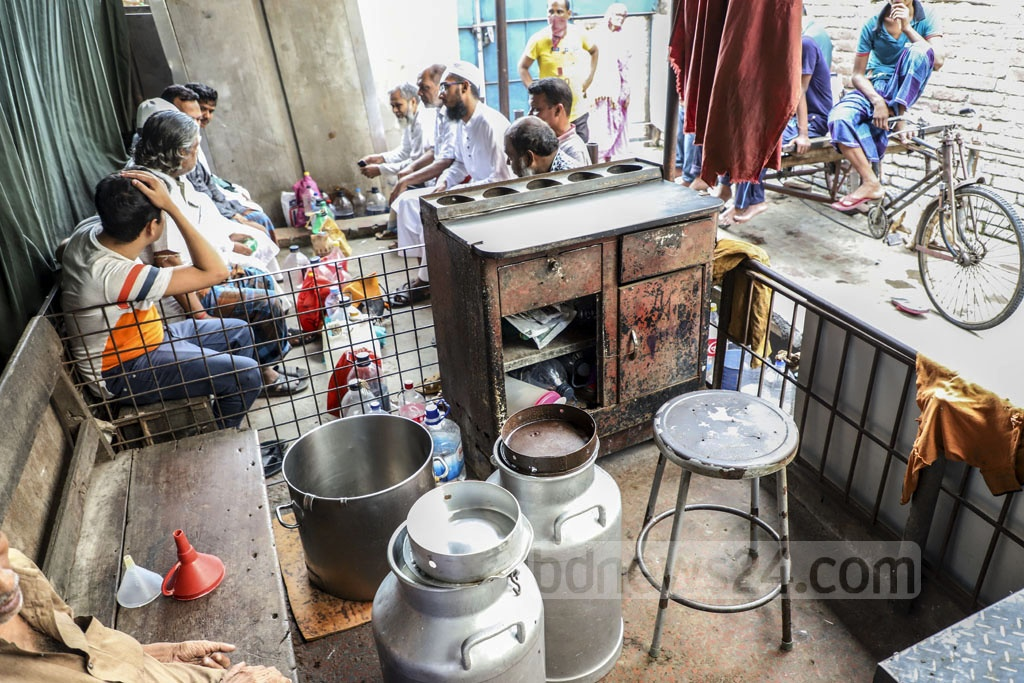 People wait at the Ananda Dairy Farm in Old Dhaka's Nimtali. The farm sells up to 400 litres of milk per day. Photo: Abdullah Al Momin