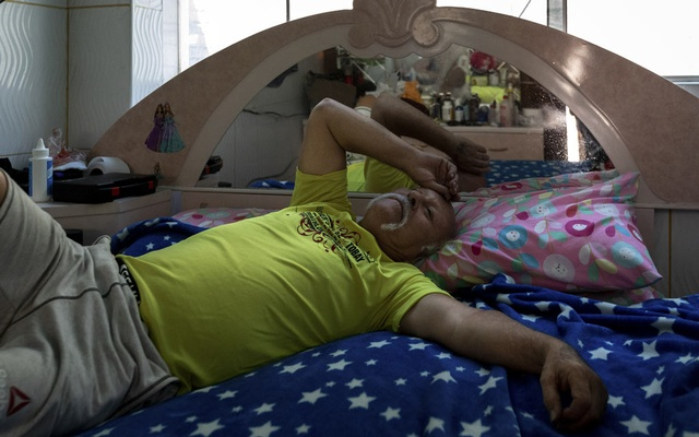 Abel Vela, a cabdriver who left his family in New York after struggling to repay his taxi medallion loan, in his room in Lima, Peru, April 30, 2019. Despite years of warning signs, agencies at every level of government did little to help New York taxi drivers as they became crushed under overwhelming debt. (Angela Ponce/The New York Times)