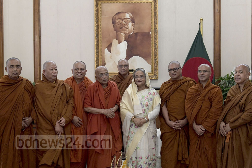 Prime Minister Sheikh Hasina greets people from the Buddhist community at a ceremony at the Gonobhaban on Monday marking the Buddha Purnima. Photo: PID