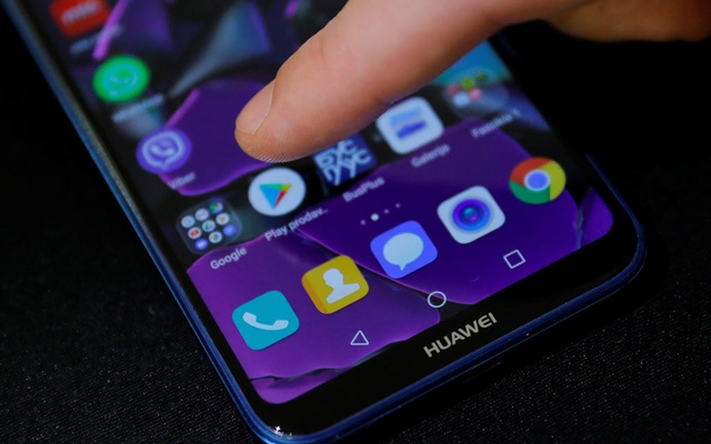 A man points a finger to the Google Play app logo on his Huawei smartphone in this illustration picture May 20, 2019. REUTERS