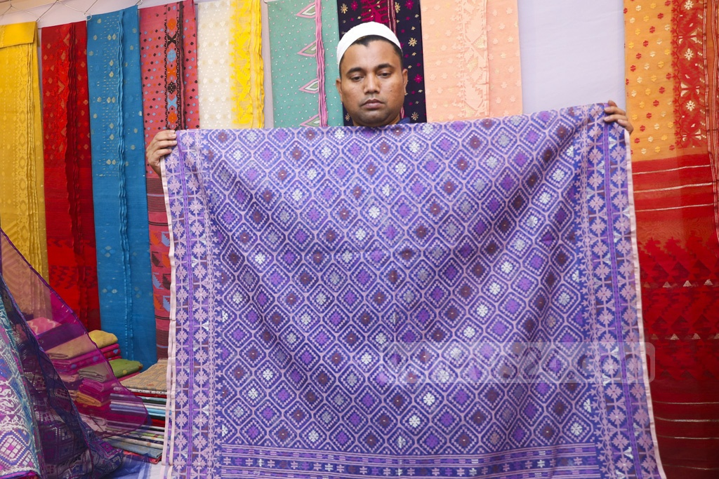 Jamdani saris on display at a stall in a fair at the Shilpakala Academy premises in Dhaka on Tuesday. Prices range from Tk 1,500 to Tk 200,000 apiece.