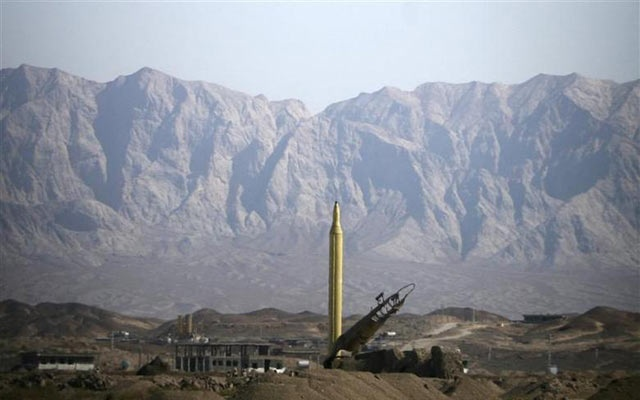 File Photo: A Ghadr 1 class Shahab 3 long range missile is prepared for launch during a test from an unknown location in central Iran, September 28, 2009. REUTERS/Fars News/Ali Shayegan