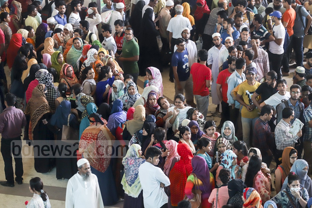 Women lined up to purchase advance Eid train tickets at Dhaka's Kamalapur Railway Station. Photo: Abdullah Al Momin