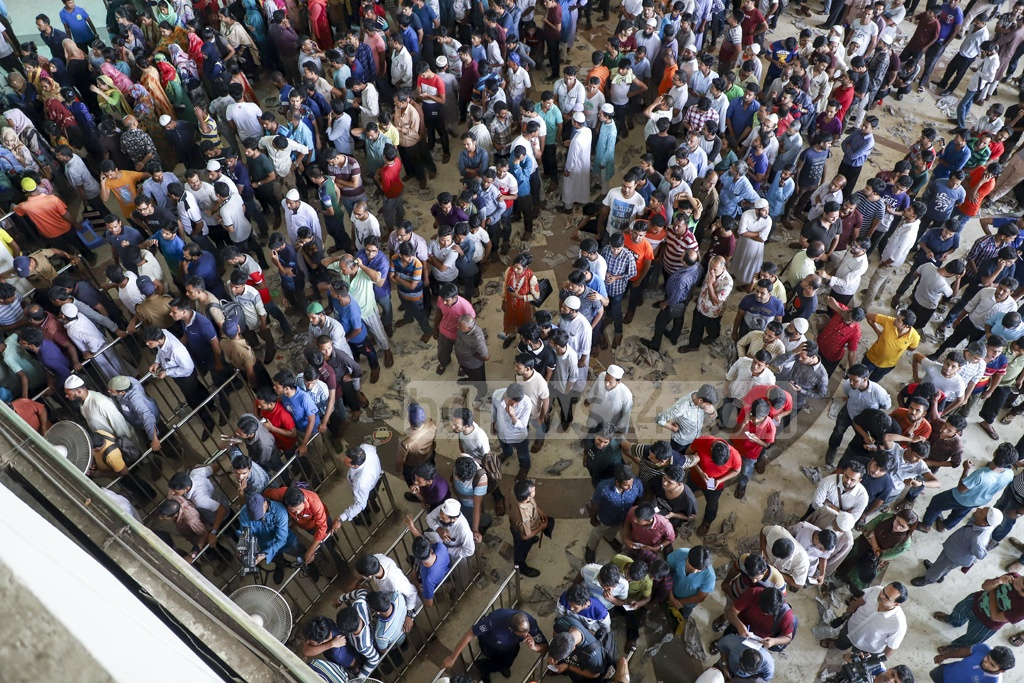 Long queues at Dhaka's Kamalapur Railway Station on Wednesday as people waited to buy advance train tickets for Eid travels on the first day of sale. Photo: Abdullah Al Momin