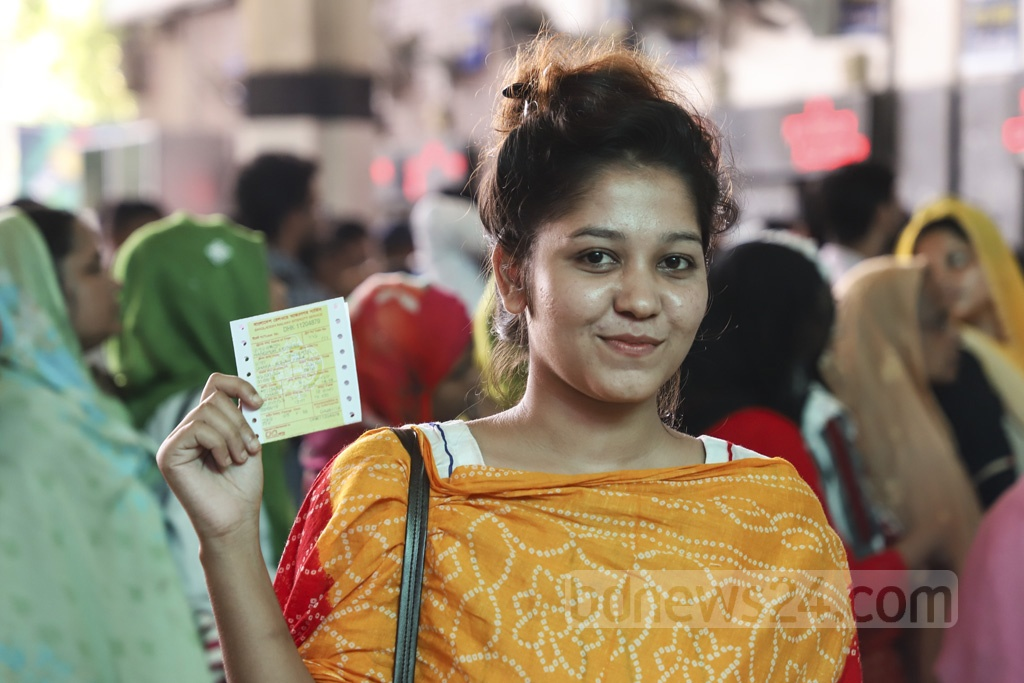 The long wait is over—her smile says it all. This woman has secured tickets to her desired destination for Eid. This photo was taken at Dhaka's Kamalapur Railway Station on Wednesday. Photo: Abdullah Al Momin