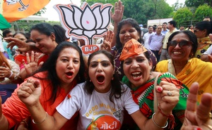 Supporters of Bharatiya Janata Party (BJP) celebrate after learning of initial poll results in Chandigarh, India, May 23, 2019. Reuters