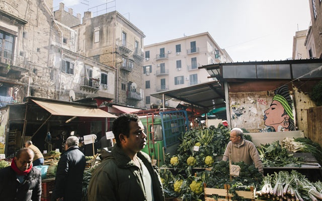The Ballarò market, filled with Sicilian staples but also such items as hyacinth pea pods, favoured by Bangladeshi immigrants, in Sicily, Italy, Jan. 16. 2019. A fear of migrants, their customs — and sometimes, their produce — has taken root in Italy, fuelling the rise of populism and the ascent of Matteo Salvini, the tough interior minister and far-right leader of the anti-migrant League party. (Gianni Cipriano/The New York Times)