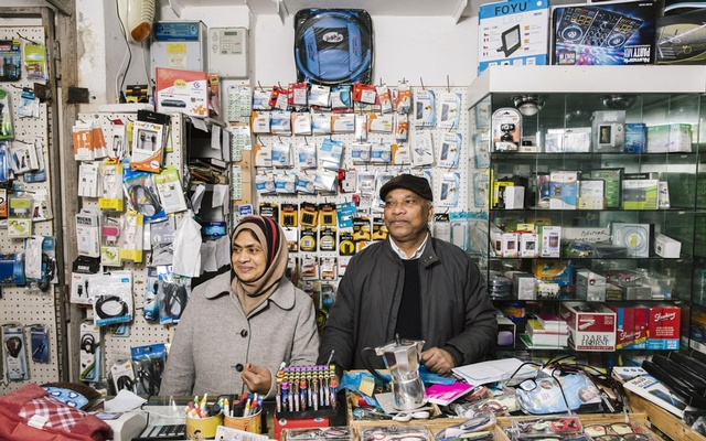 Uddin Mohammed Siraj, right, and his wife, Rina Uddin, from Bangladesh, in their shop at the Ballarò market, in Sicily, Italy, Jan. 16. 2019. A fear of migrants, their customs — and sometimes, their produce — has taken root in Italy, fuelling the rise of populism and the ascent of Matteo Salvini, the tough interior minister and far-right leader of the anti-migrant League party. (Gianni Cipriano/The New York Times).