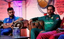 FILE PHOTO: Cricket - ICC Cricket World Cup - Captains Press Conference - The Film Shed, London, Britain - May 23, 2019 Pakistan's Sarfaraz Ahmed and India's Virat Kohli during the press conference. Action Images/Andrew Boyers/Pool/File Photo
