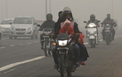 FILE PHOTO: People commute on a smoggy morning in New Delhi, India, Nov 8, 2017. REUTERS
