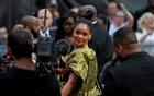 Cast member Rihanna poses for pictures as she arrives for the European premiere of Ocean's 8 in London, Britain Jun 13, 2018. REUTERS