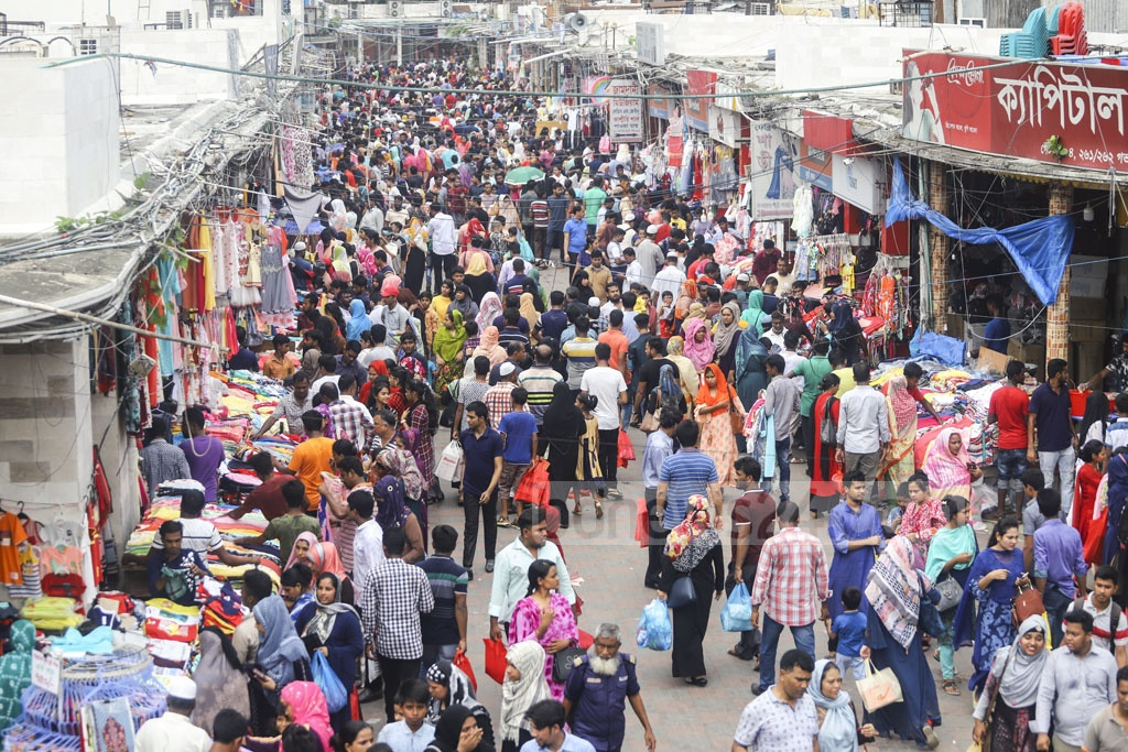 Crowds gather at New Market in Dhaka on Friday, a weekly holiday, ahead of Eid-ul-Fitr. Photo: Asif Mahmud Ove