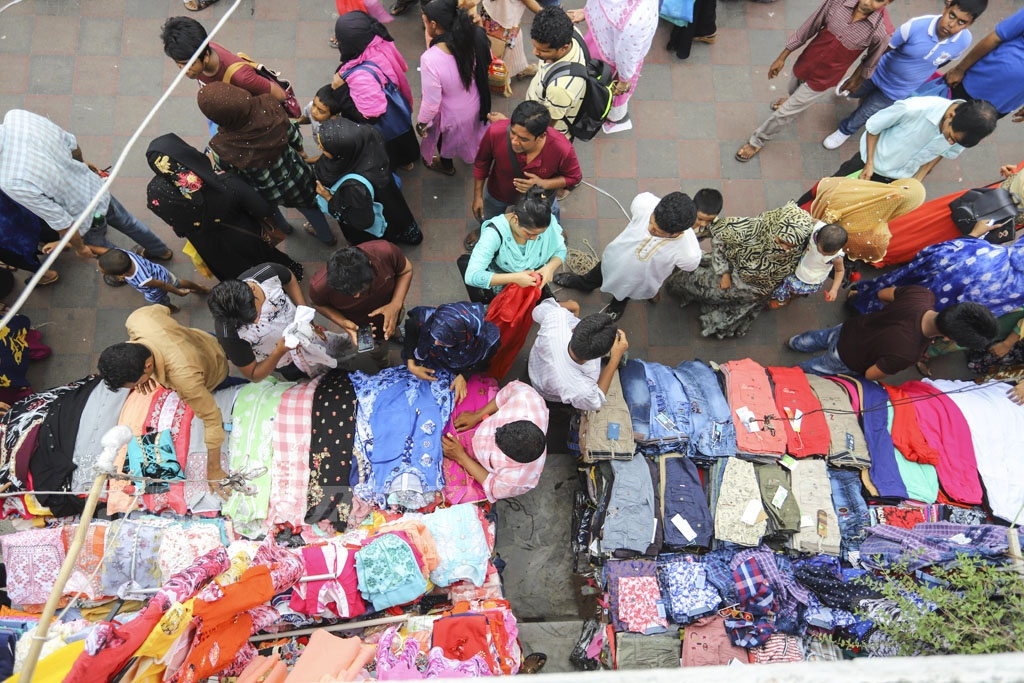 Eid shoppers throng New Market in Dhaka on Friday. Photo: Asif Mahmud Ove