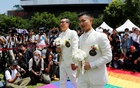 Gay newlyweds walk on a giant rainbow flag at a pro same-sex marriage party after registering their marriage in Taipei, Taiwan May 24, 2019. REUTERS
