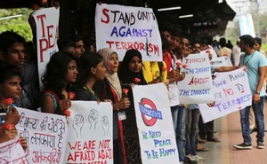 Representational Image: College students hold placards during a rally to condemn terrorism at a railway platform in Mumbai. Reuters