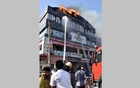 Firefighters douse a fire that broke out in a four-storey commercial building in Surat, in the western state of Gujarat, India, May 24, 2019. REUTERS