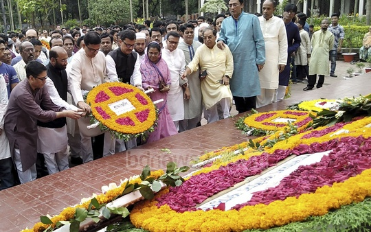Awami League leaders headed by Joint General Secretary Mahbub-Ul Alam Hanif pay respect to National Poet Kazi Nazrul Islam by placing a wreath on his grave in Dhaka on his 120th birth anniversary on Saturday.
