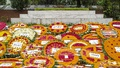 Flowers cover the grave of Kazi Nazrul Islam in Dhaka got as people and different organisations paid respect to the national poet on his 120th birth anniversary on Saturday.