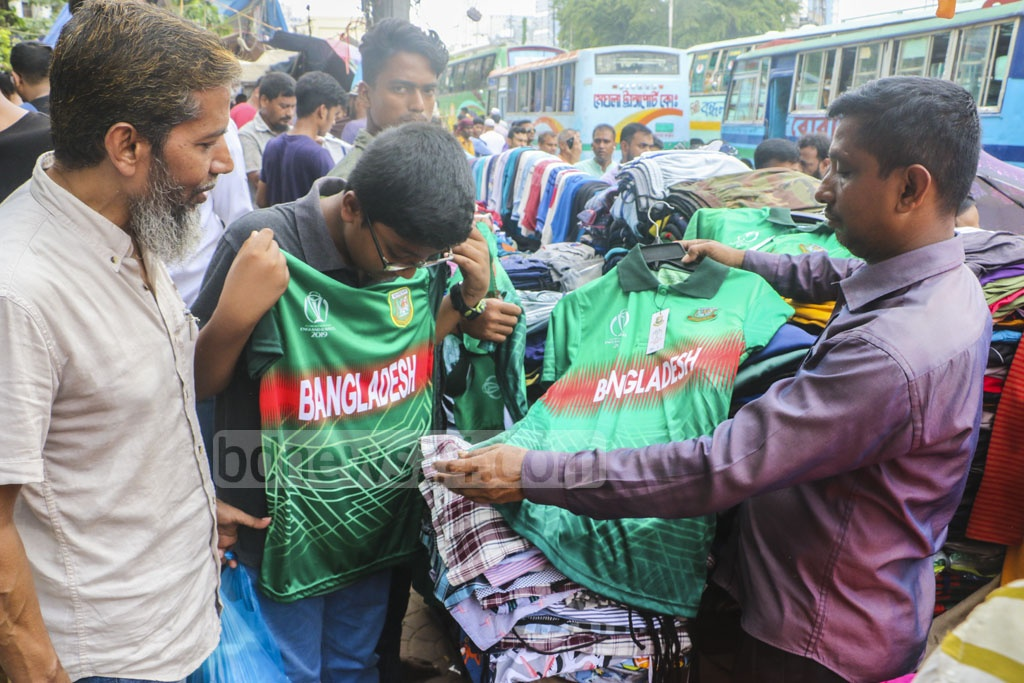 With the ICC World Cup in England and Wales looming large, fans of the Tigers flocked to footpath shops in Dhaka's Gulistan to buy replica jerseys of the Bangladesh cricket team.