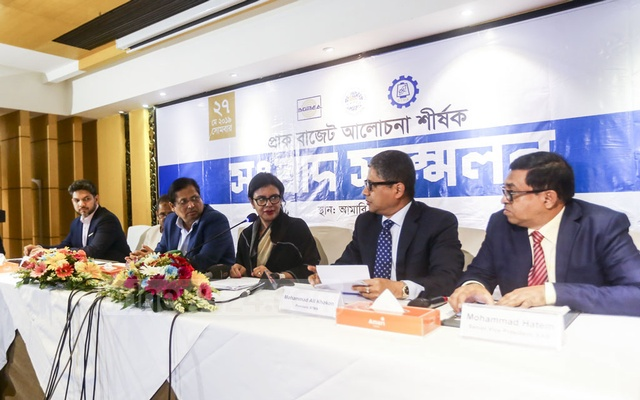 Speakers attend a pre-budget meeting jointly organised by BGMEA, BKMEA and BTMA at Amari Dhaka Hotel on Monday. Photo: Mahmud Zaman Ovi