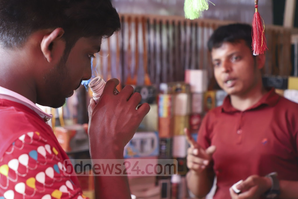 Ahead of the Eid-ul-Fitr, customers are buying attar from a shop at the Baitul Mukarram National Mosque market. Photo: Abdullah Al Momin