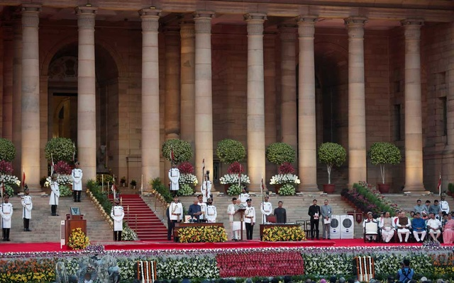 India's President Ram Nath Kovind administers the oath of India's Prime Minister Narendra Modi during a swearing-in ceremony at the presidential palace in New Delhi, India May 30, 2019. Reuters