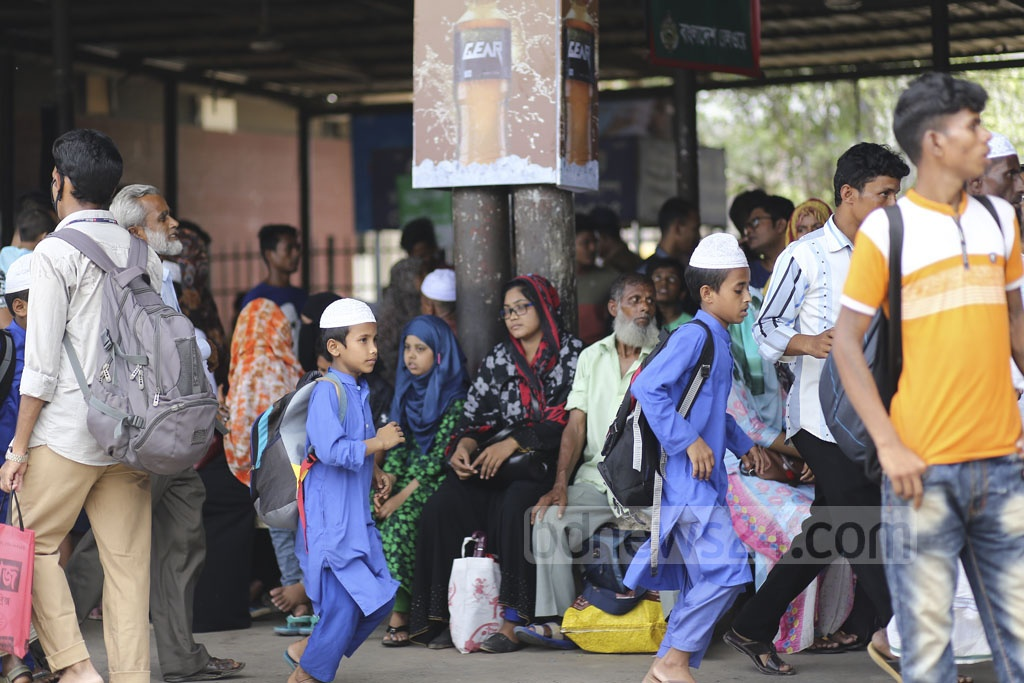 Homebound people waiting for a train at Dhaka Airport Railway Station on Thursday. Photo: Mahmud Zaman Ovi