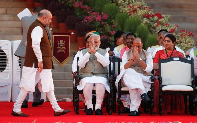 India's Prime Minister Narendra Modi greets Amit Shah during a swearing-in ceremony at the presidential palace in New Delhi, India May 30, 2019. Reuters