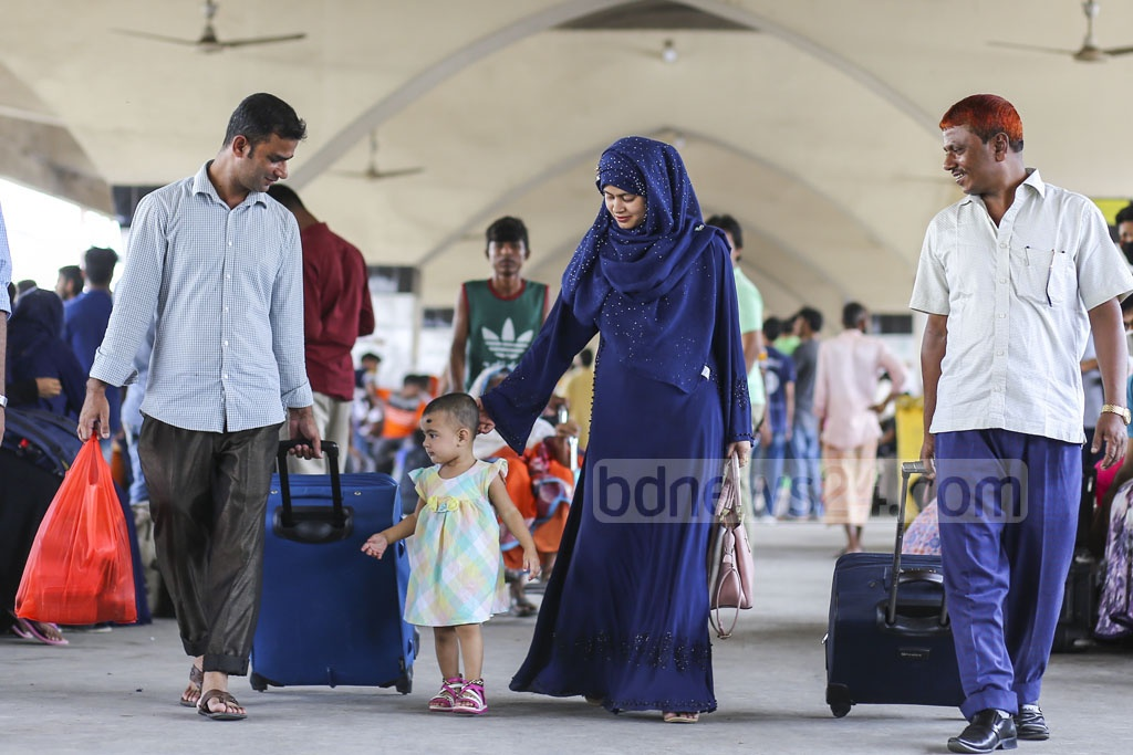 Eid holidaymakers thronging the railway stations in Dhaka on Friday to leave the capital for home and spend the holidays with their loved ones. This photo was taken from Kamalapur Railway Station. Photo: Mahmud Zaman Ovi