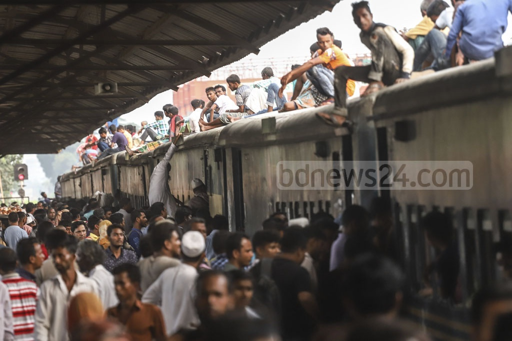 Eid holidaymakers thronged the railway stations in Dhaka on Friday to leave the capital for home and spend the holidays with their loved ones. This photo was taken from Airport Railway Station. Photo: Abdullah Al Momin