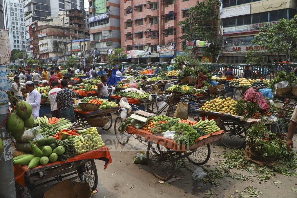 Traders who sell vegetables and fruits on rickshaw vans set up a makeshift market on the street at Naya Paltan in Dhaka every Friday after Juma'a prayers targeting Muslim worshippers as customers. Photo: Abdullah Al Momin