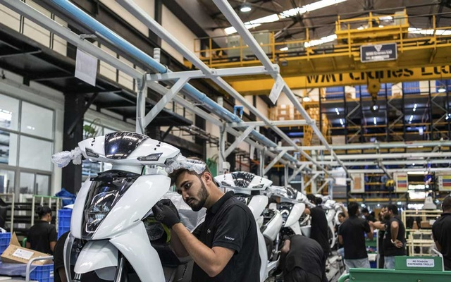 FILE -- An assembly line at a scooter factory in Bangalore, India, April 24, 2019. The Indian government's official data shows the economy expanding 7 to 8 percent a year, rivaling or exceeding China. (Rebecca Conway/The New York Times)