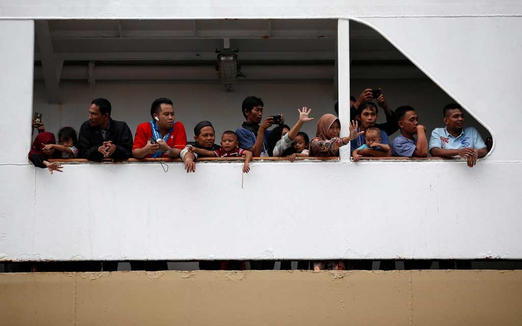 People wave from the deck of Dobonsolo ship to Semarang as they head to their hometowns to celebrate the upcoming Eid al-Fitr at Tanjung Priok port in Jakarta, Indonesia, June 1, 2019. REUTERS/Willy Kurniawan