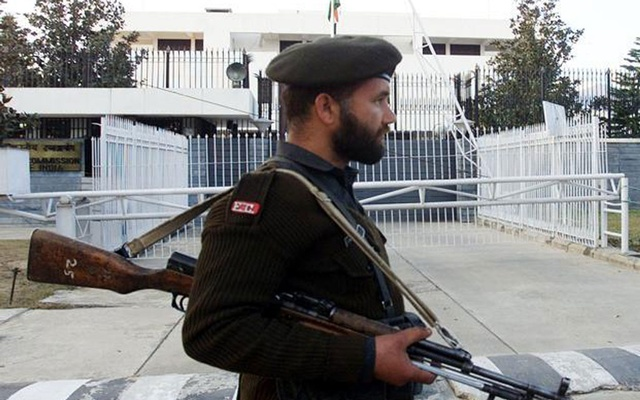 File Photo: A Pakistani soldier stands guard in front of the Indian High Commission in Islamabad. Reuters