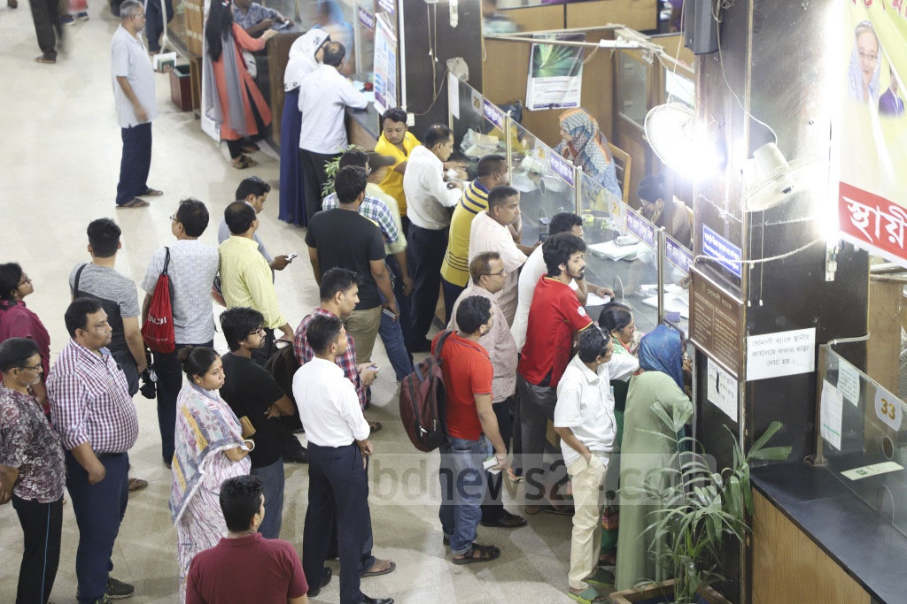 Customers form long queues at banks on the last working day before Eid-ul-Fitr. Photo: Abdullah Al Momin