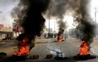 Sudanese protesters use burning tyres to erect a barricade on a street, demanding that the country's Transitional Military Council hand over power to civilians, in Khartoum, Sudan Jun 3, 2019. REUTERS