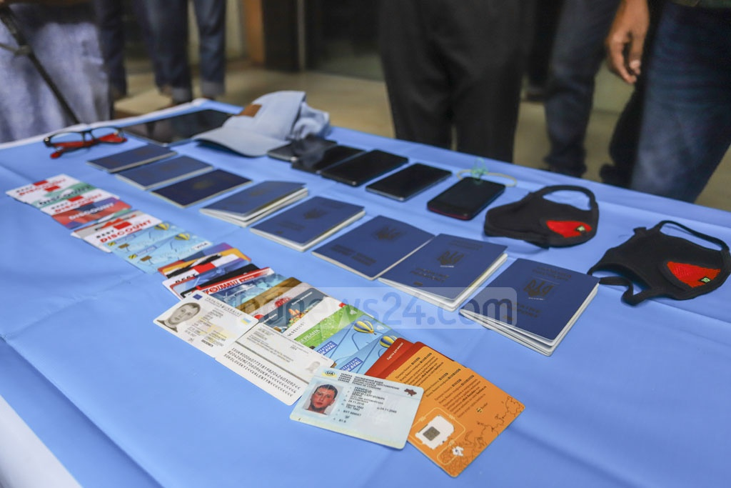 Mobile phones, bank cards, and other stuff seized from six Ukrainians, arrested on charges of ATM fraud, on display at a police news conference in Dhaka on Tuesday. Photo: Asif Mahmud Ove