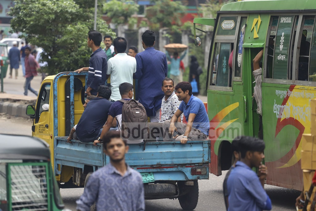 Commuters riding a pickup on Tuesday as the number of public transport in the capital dropped due to Eid-ul-Fitr holidays. Photo: Asif Mahmud Ove